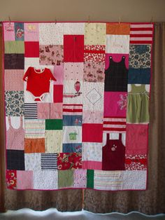Baby clothes Quilt *I like that there is depth to this quilt with some of the outfits being left whole.*