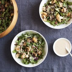 A luscious salad full of Middle Eastern flavor, including za'atar roasted cauliflower & red onion, lentils, and harissa tahini dressing.