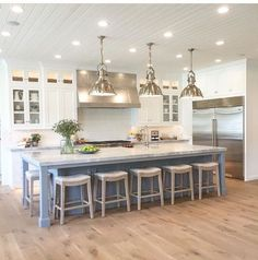 Love the floors, white cabinets and alternate color on the island (maybe gray, brown, black?) like that the bar stools fully slide under the counter: