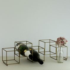 Metal Cube Wire Bottle Holder: This Metal Cube Wire Bottle Holder is beautiful way to store and display your bottles in a  minimalist and stylish way. The copper finish metal wire rack can hold up to 5 bottles per rack and will look delightful in a kitchen, hallway or bar area. The rack can also stack with another to give you as much/or as little storage as you want. The on-trend metallic finish and staggered effect, gives this wine storage such a contemporary and industrial vibe.