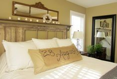 Love the shelf above the headboard and the wedding date on the pillow