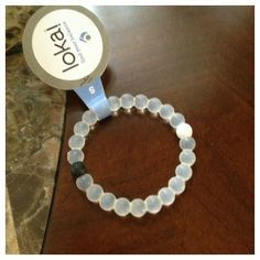 Lokai Bracelet: Finding Balance in Your Own Life This bracelet is very meaningful and I really want one.The white bead ,representing the highest point on earth,is injected with water from mount everest.The balck bead,representing the lowest point on earth,is injected with mud from the dead sea.All the clear beads mean that the path is for you to make.
