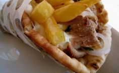 The famous Greek Pita Gyros! Gyros is meat roasted on a vertical spit. Also commonly served in a sandwich, called pita gyro, with tomato, potatoes and tzatziki sauce! www. Greek Pita, Greek Gyros, Eat Greek, Greek Recipes, Vegan Recipes, Snack Recipes, Pita Sandwiches, Pork Fillet, Filling Snacks