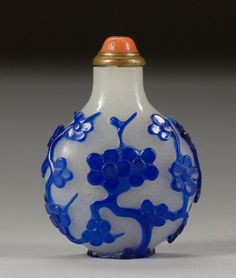 Cameo Glass Snuff Bottle, 19th century, blue overlay carved design of a flowering prunus branches, coral stopper. H:  2.25""