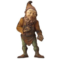 Antique Cast Iron Gnome | From a unique collection of antique and modern garden ornaments at http://www.1stdibs.com/furniture/building-garden/garden-ornaments/
