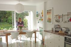Designer's house- Light and airy kitchen extension with alu-clad sliding doors by DHV architects.