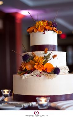 gorgeous orange and purple fall wedding cake!!  I think I would like it best without the twig things lol