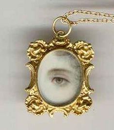 Lover's eye pendant, hand-painted on ivory and set in 18K gold. Circa early to mid 1800s. Back of pendant has a compartment for hair.