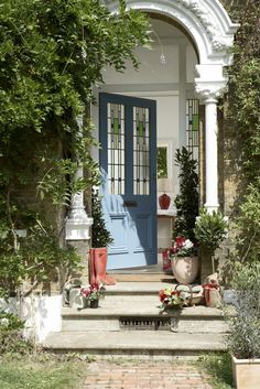 Create great curb appeal and a calming welcome to your home with a smart blue painted door and add shiny new house numbers for a quick and easy update. Fill pots with classic bay trees or, if you want something that smells wonderful as you approach the front door, try lavender. Photography: Mark Scott. Find more outdoor ideas at housebeautiful.co.uk