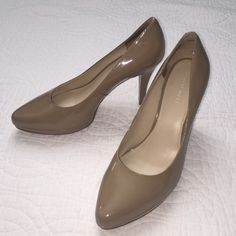 Nine West nude heels Worn a few times but still in good condition. A couple minor dents on the heels but not noticeable and no tears in the leather. 4 inch heel with about a half inch platform. Nine West Shoes