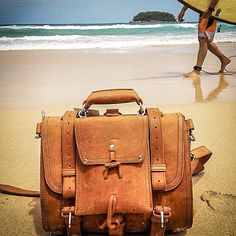 in the sand at Kata Beach, Phuket. | Saddleback Leather Co. | 100 Year Warranty