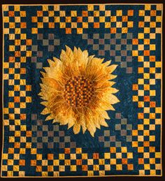 The stitched squares on the background connect the border with the sunflower
