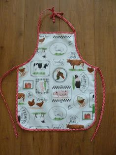 Lekker Fleurig, schortje, kinder schort, kinderschort, apron, kids apron, tafelzeil, oilcloth