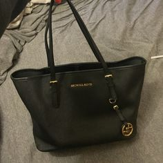 MICHAEL KORS JET SET SAFFIANO LEATHER SM TOTE Michael Kors JET SET TRAVEL SAFFIANO LEATHER SMALL TOTE. Only getting rid of it because it has become too small for all of my work stuff. In great condition. Genuine MK Leather Bag. Michael Kors Bags Totes