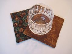 This set of 4 or 6 rustic pine cone reversible coasters is a great choice for a splash of fall or winter your home. One side has is made with a rich seasonal fabric with small brown pinecones and green evergreens. On the reverse side is a brown vine print. Reversible coasters are double stitched on the edges to keep them looking great wash after wash. Lined with a thin layer of polyester batting to prolong durability and shape. All fabrics I choose to work with are high quality 100% cotton…