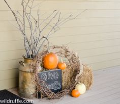 Thanksgiving front porch decor - chalkboard, vintage milk jug, wreath, burlap, hay bale, pumpkins