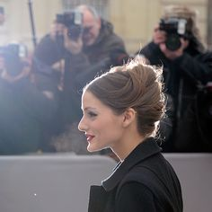 Brides.com: Olivia Palermo's Most Wedding-Worthy Hairstyles. A Classic French Twist  What better place to wear a French twist than in Paris? Palermo didn't miss her chance to do so when she stepped out in this utterly romantic updo. The epitome of French chic, this is a hairstyle that sophisticated, uptown brides will fawn over.  See more romantic wedding hairstyles.