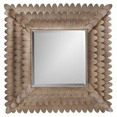 """Add a chic accent to your bedroom or foyer with this eye-catching mirror, framed by scalloped tiers of richly textured bronze-hued metal.   Product: Wall mirrorConstruction Material: Metal and mirrored glassColor: BronzeDimensions: 35"""" H x 34"""" W x 2"""" D"""
