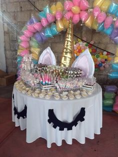 Love this idea with the oversized ears and unicorn horn on the cake table. Should use an iridescent linen or sequence linen.