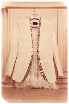 so love this glitter trimmed white blazer. chic and not over the top. cheers, dana