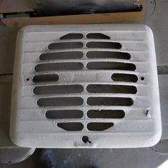 many years of bad painting on this old extractor vent.