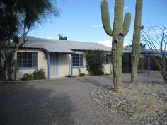 Charming Central Tucson 2BR/1BA ... 1950's brick ranch home with artistic touches throughout. Home features 18'' tile in living areas, carpet in bedrooms, updated bathroom, refrigerator included. Lot features mature saguaros & ocotillos, circle driveway, 1 car garage and 1 car carport, deep covered north facing back patio, storage building, mature trees & mountain views. Located near DMAFB and close to the UofA. Possible Short Sale. Home to be sold As Is.