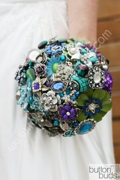 THIS!!  purple,turquoise,green theme peacock theme wedding brooch bouquet  #timelesstreasure