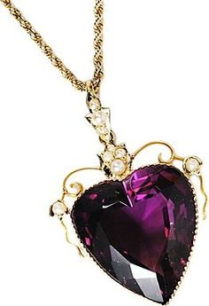 Heart-shaped amethyst pendant with gold and seed pearl setting, English, c. Hearts were among the most desired jewelry motifs of the Edwardian age and this turn-of-the century pendant displays the design in its entire splendor. Purple Jewelry, Amethyst Jewelry, Amethyst Pendant, Antique Jewelry, Vintage Jewelry, My Birthstone, Heart Jewelry, Shades Of Purple, Violet
