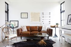 Love this super chic living room featured in @lonnymag Sharing where to find this gorgeous gold wheat coffee table for only $295 vs $2000 :X #ontheblog #CopyCatChic