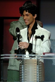 Prince was all smiles as he was inducted into the Rock and Roll Hall of Fame in 2004. He performed with other stars like Tom Petty and Dhani Harrison before accepting the honor.