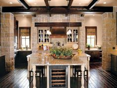 Country Kitchen with Ashlar Santa Barbara, Wine refrigerator, U-shaped, Simple granite counters, Breakfast bar, Raised panel