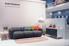 Swell Sofa with Cloud Cushions, Oona Carpet, Kabino Sideboard, Tablo Table and the Hello Lamp at Maison & Objet in Paris.  (720×481)