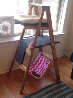 DIY cat tree made from an old wooden ladder, outdoor carpeting, left over wood and jute wrapped around the bottom for a scratching post. Hammock is just material and a towel. Super fun, cheap and easy to make! by elvia