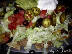 These Ultimate Nachos are great anytime. They are a hearty and healthy choice for lunch or dinner. A snap to serve while watching TV, playing cards, entertaining or enjoying the BIG GAME.