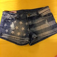 """Like New Hot Kiss Distressed Flag Shorts size 10 Shorts have 2""""inseam, also have stretch to them! Super cute for summer, Memorial Day, 4th of July, every day!! Waist is 15"""" across laying flat. Distressed look, very chic & trendy!! Hot Kiss Shorts"""