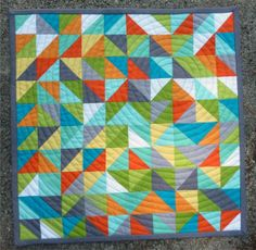 That's So Random!  Just half square triangles .... with circular quilting .. LOVE it!