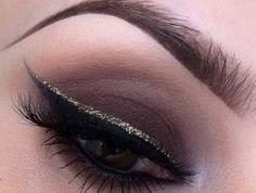 Deep brown smokey eye with glitter eyeliner . Holiday makeup Christmas makeup