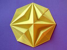 Origami: Stella in ottagono 2 - Octagonal Star 2 . Designed and folded by Francesco Guarnieri, August 2007. http://guarnieri-origami.blogspot.it/2012/12/stella-in-ottagono-2.html