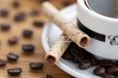 cup and saucer, coffee beans with cookie sticks - Close-up shot of cup and saucer, coffee beans with cookie sticks