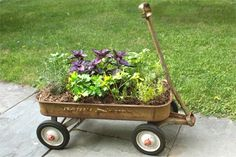 Looking to spice up your container garden? Dig out Junior's rusty old Radio Flyer and turn it into a mobile planter that can go from a sun-steeped corner right to your kitchen door. Here's how to get rolling. | Photo: Amy Rosenfeld | thisoldhouse.com