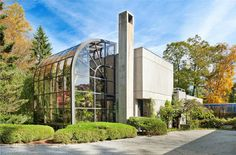 Twin Ponds 55 Springhurst Road, Bedford Hills, New York, United States, 10507  Twin Ponds, a stunning modernist structure of glass and concrete, is the masterpiece of the late Robin Roberts, founder and owner of Clarence House and architect Milton Klein