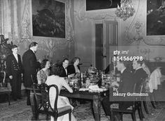 Conservative MP Thomas Fermor-Hesketh, 1st Baron Hesketh (1881 - 1944, at far end of table) dining with members of his family before departing for war work, at Easton Neston, Northamptonshire, c1940.