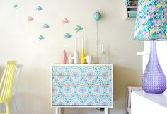 Pastel flying birds + gorgeous patterned drawers