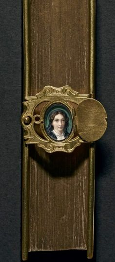book clasp portrait with cover, artist unknown, 1800s (?).  WONDERFUL.