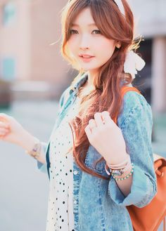 Chambray shirt, lace blouse and bow in hair
