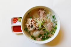 Ho Chi Minh City (also still called Saigon) is famous for its pho (traditional Vietnamese noodle soup) and pork rolls. Pork Roll, Vietnamese Recipes, Vietnamese Noodle, Beef Noodle Soup, Top 5, Thai Red Curry, Rolls, Food And Drink, Dishes