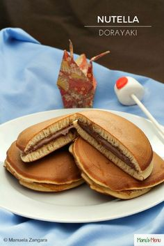 Nutella Dorayaki - Dorayaki (どら焼き) is a classic Japanese confection, made up of two fluffy honey pancakes sandwiched together and filled with Nutella.
