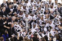 Chicago Blackhawks players and coaches celebrate with the Stanley Cup after they defeated the Bruins in Game 6 of their NHL Stanley Cup Finals hockey series in Boston Nhl Stanley Cup Finals, 2013 Stanley Cup, Stanley Cup Champions, Chicago Blackhawks Players, Boston Bruins Hockey, Hockey Games, Ice Hockey, In Boston, Espn