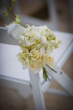Garden Chair arrangement made with Hydrangeas, Roses, and  Dendrobium Orchids