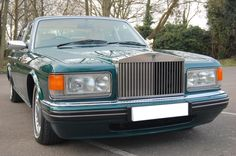 1997 P Rolls Royce Silver Spur MK IV. Finished in Brooklands Green with Magnolia interior with Spruce piping with Spruce carpets piped in Magnolia with Burr Oak Veneers and fitted picnic tables and reclining rear seats. Only one owner with 77,000 miles and Full Service History. Immaculate condition throughout £26.950 Full Details:  http://hanwells.net/rolls-royce-select/silver-spur-selection/1997-p-rolls-royce-silver-spur-mk-iv-in-brooklands-green-26-950